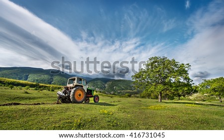 Tractor digging a channel for drainage of water in the mountains!