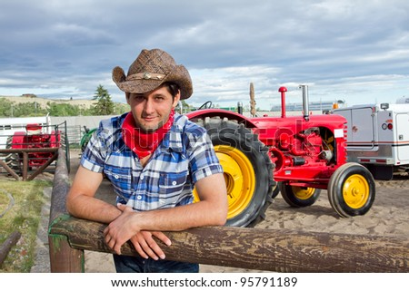 Tractor driver in western clothing. Calgary Stampede 2011, Alberta, Canada - stock photo