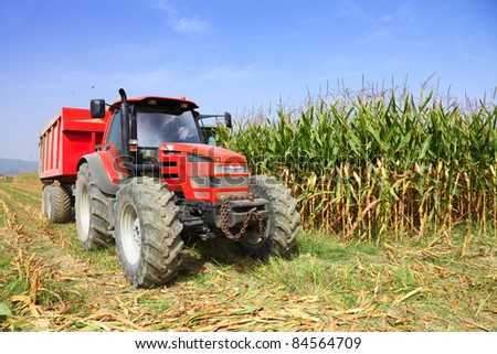 tractor farming in rural field - stock photo