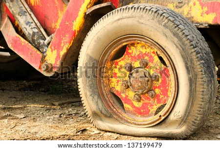 Tractor flat tyre - stock photo