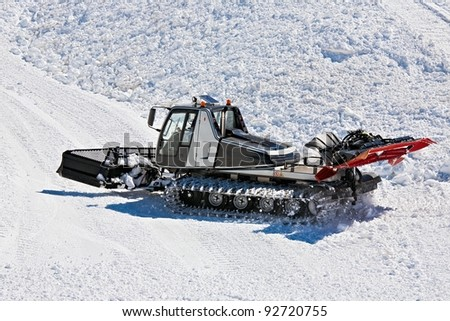 tractor for snow preparation - stock photo