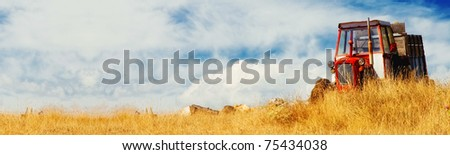Tractor in a field (banner) - stock photo