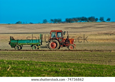 Tractor in field - stock photo