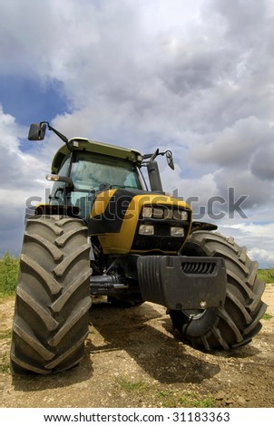 Tractor in the field with a cloudy sky