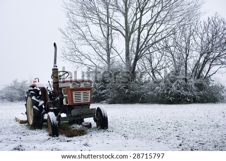 Tractor in the snow - stock photo