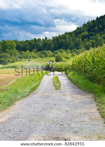 Tractor on dusty road
