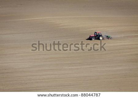 Tractor on Field at autumn - stock photo