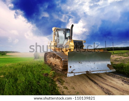 Tractor on grass field in Farm - stock photo