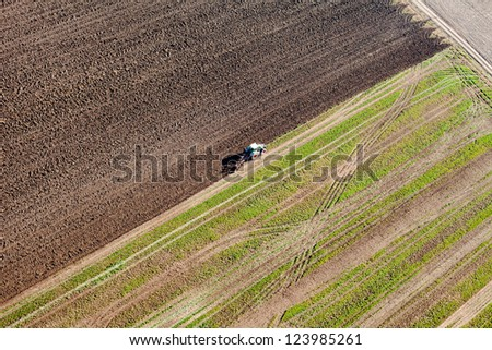 tractor on harvest field aerial view