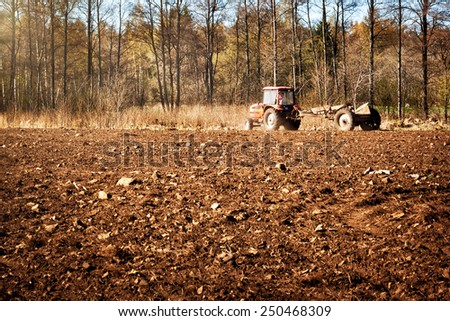 Tractor on pasture - stock photo