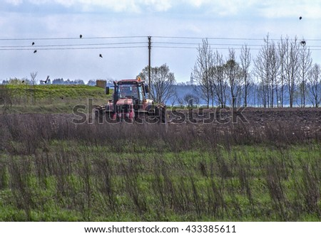 Tractor plowing a field in the spring.