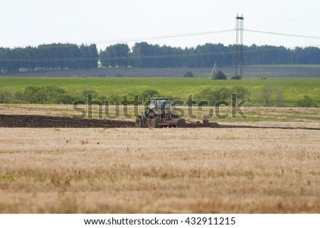 tractor plowing the field for planting in a Sunny  day