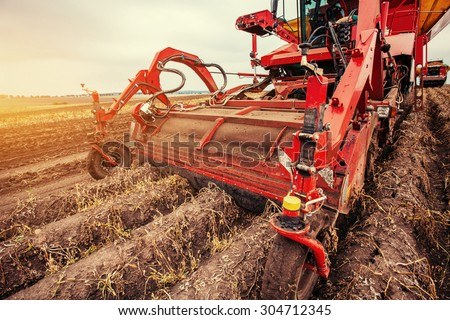 Tractor plowing up the field. - stock photo