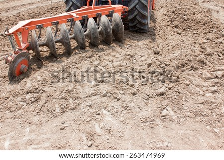 tractor preparing land for sowing - stock photo