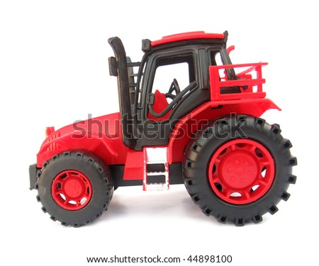 Tractor red toy on white - stock photo