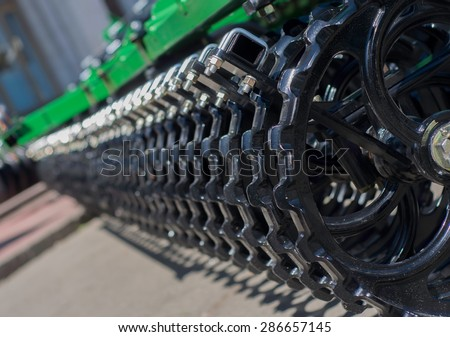Tractor seeder, repeating elements - stock photo