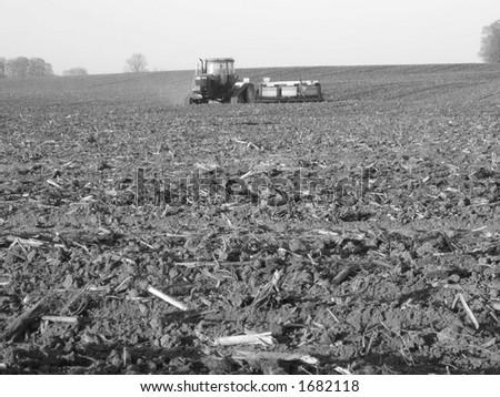 tractor speading manure on fields - Southwestern Ontario - stock photo