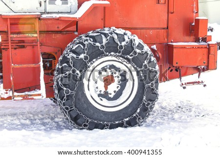tractor tire for snow removal in the winter in Kamchatka - stock photo