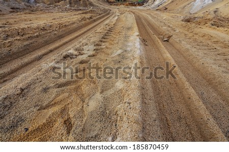 Tractor tire tracks on ground, in construction site - stock photo
