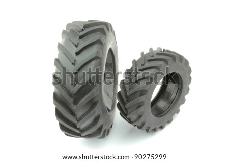 Tractor tires on white background - stock photo