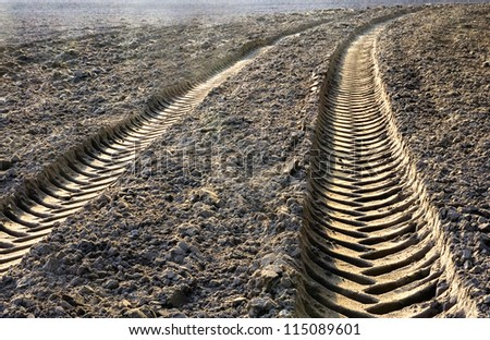 tractor traces in ground - stock photo