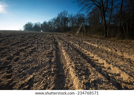 tractor traces in plowed field - stock photo