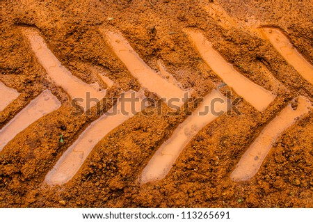 Tractor trail closeup on the muddy ground  after rain - stock photo