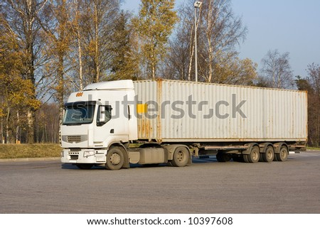 """tractor trailer truck on background  - See similar images of this """"Business vehicles"""" series in my portfolio - stock photo"""