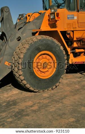 Tractor wheel - stock photo
