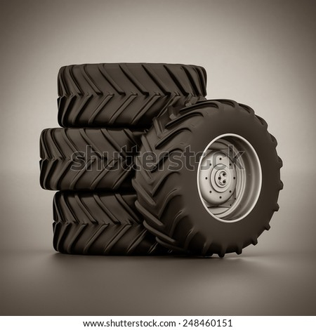 Tractor wheel isolated on gray background. black and white - stock photo