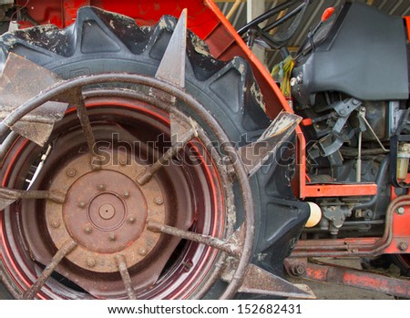 Tractor wheel on white background