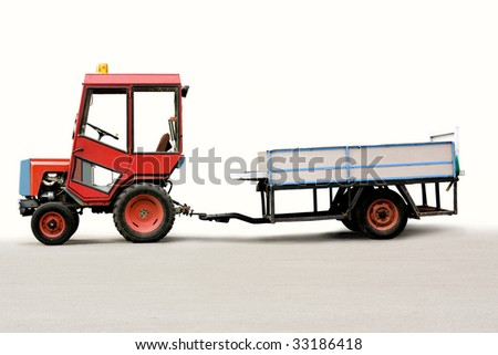 tractor with trailer. clipping path included. - stock photo