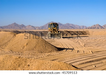 Tractor works in desert