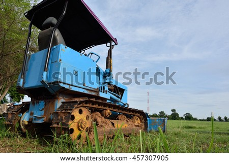Tractors for farming on the prairie. - stock photo