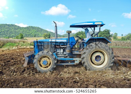 Tractors preparing the soil for planting.