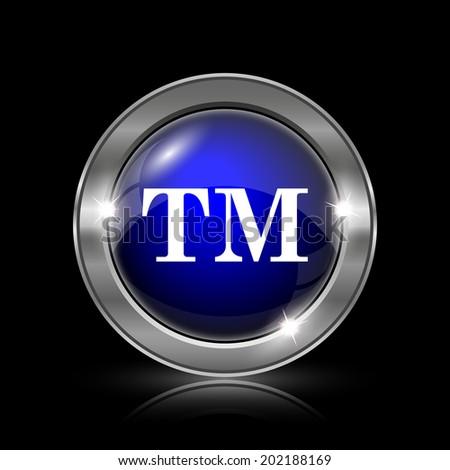 Trade mark icon. Metallic internet button on black background.  - stock photo
