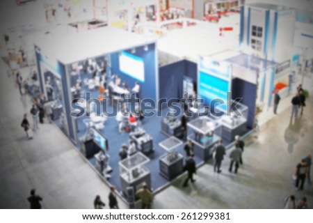 Trade show people, background. Intentionally blurred editing post production. - stock photo