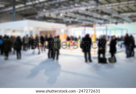 Trade show people. Intentionally blurred post production background. - stock photo