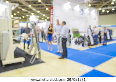 Trade show people, intentionaly blurred background