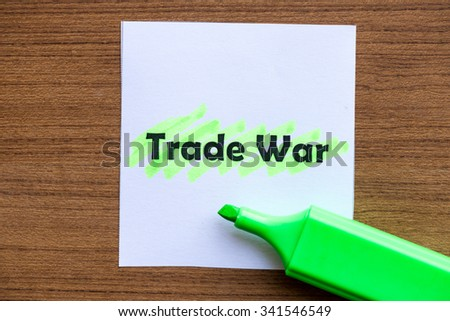 trade war word highlighted on the white paper