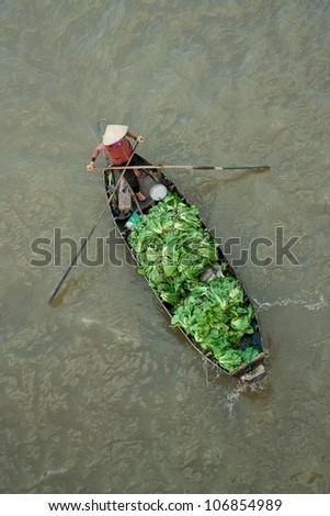 Trader on floating asia market - stock photo