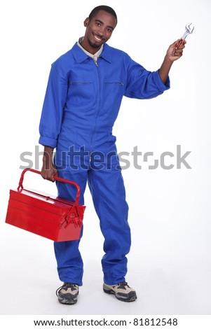 tradesman carring tools - stock photo