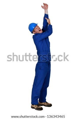 Tradesman crying out in pain - stock photo