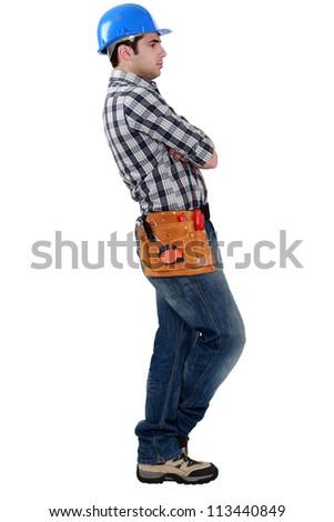 Tradesman deliberating - stock photo