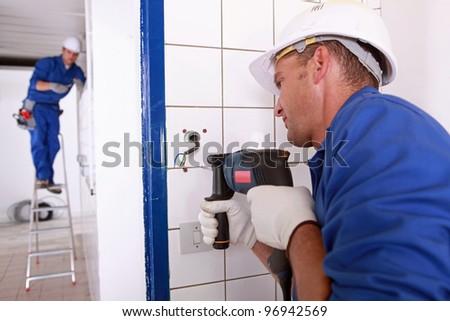 tradesman drilling - stock photo