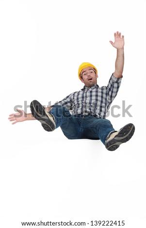 Tradesman falling through the air - stock photo