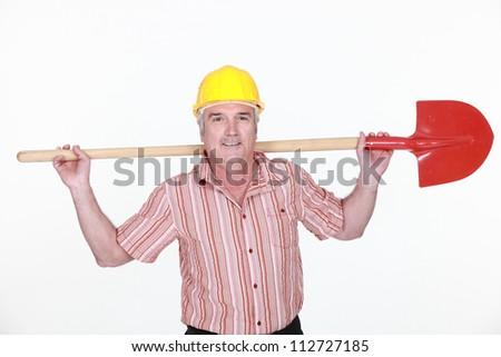 Tradesman holding a shovel - stock photo