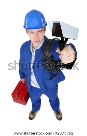 Tradesman holding a surveillance camera - stock photo