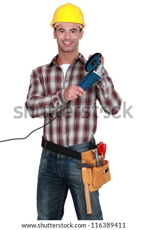 Tradesman holding an angle grinder - stock photo