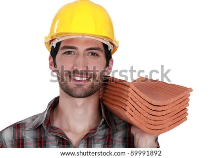 Tradesman holding shingles - stock photo